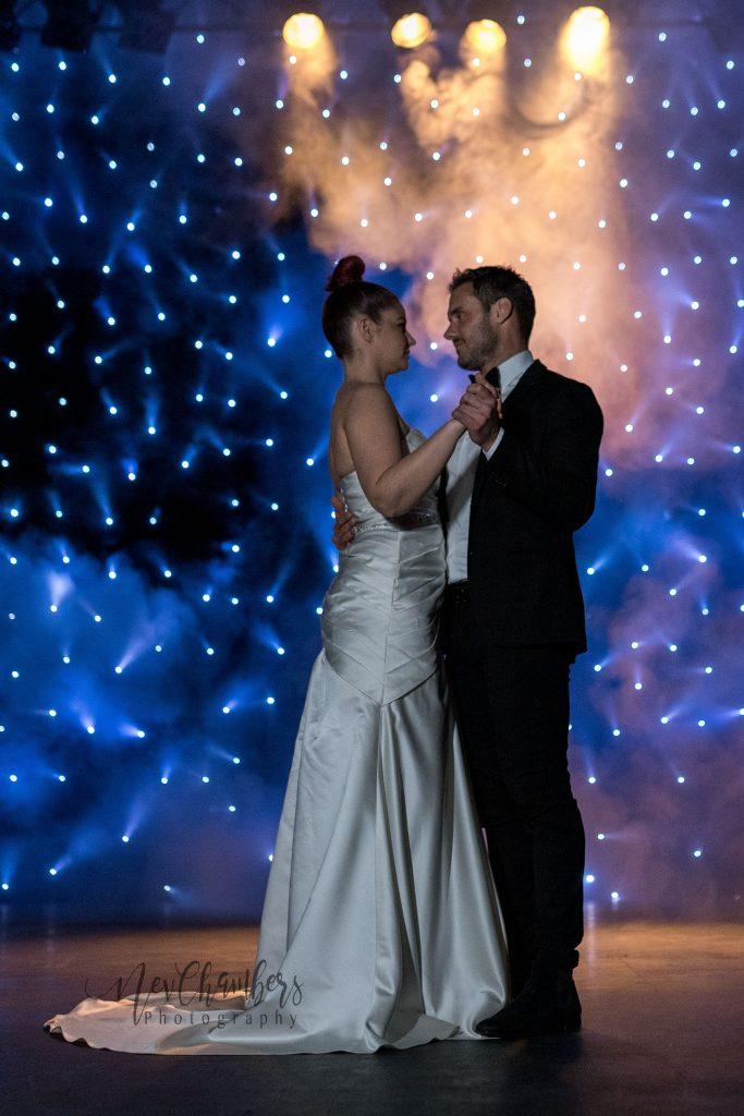 Bride and Groom dancing. Starry backdrop.
