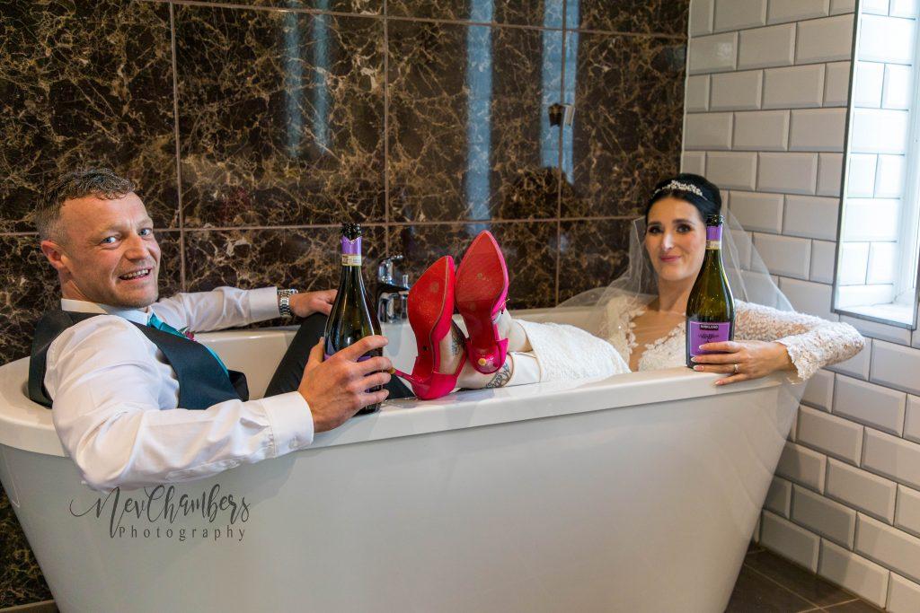 bride and groom n the bath at Ramside hall